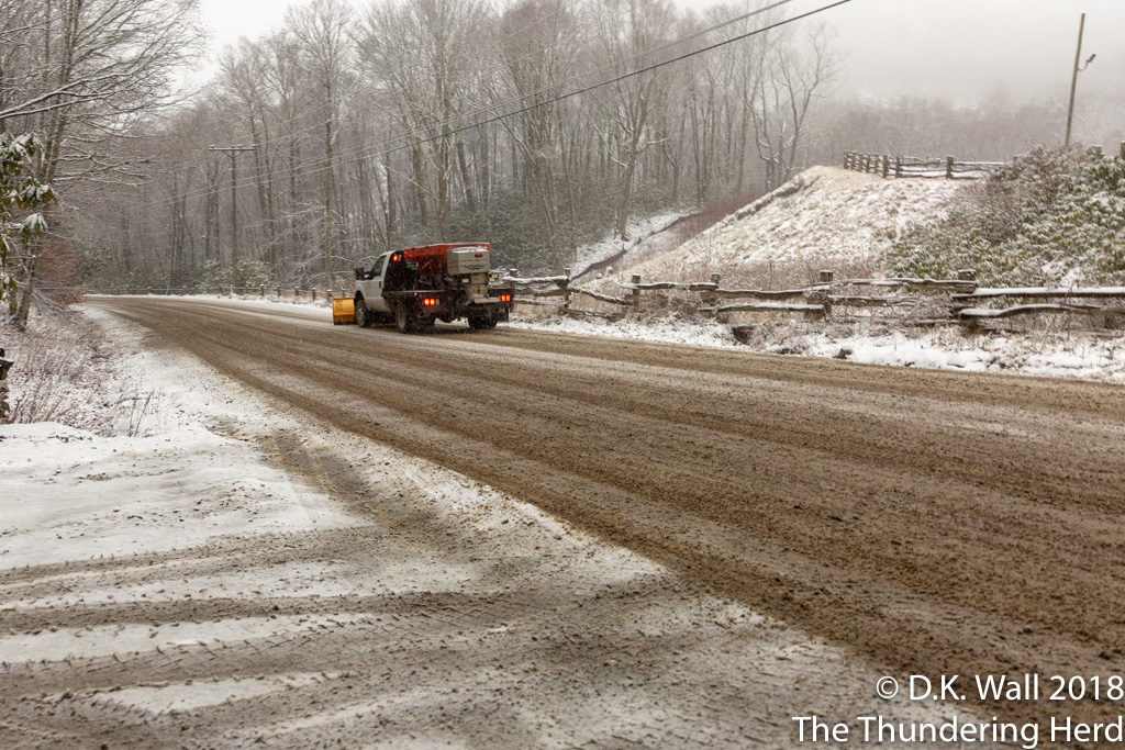 "The ski area's snow plows were keeping the ""main"" road open."